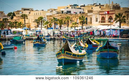 traditional fishing boats near market in fishing village of Marsaxlokk (Marsascala)