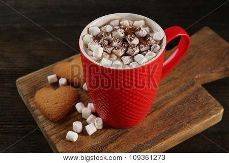 A cup of tasty cocoa and marshmallow on the table