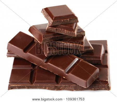 Black chocolate pieces isolated on white background