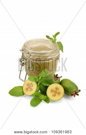 Feijoa marmalade in a jar made of fresh berries on white background.