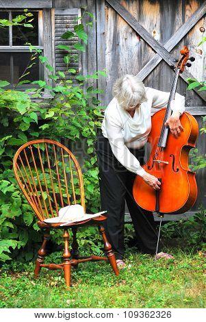 Mature female cellist.