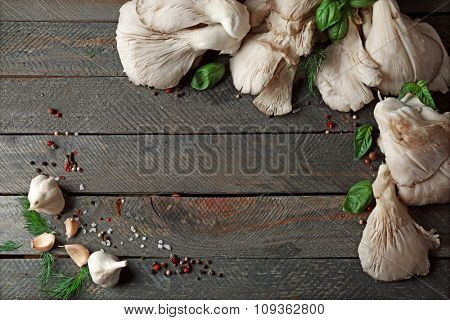 Fresh mushrooms on wooden background