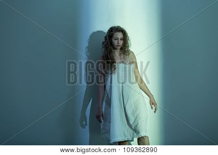 Scared Woman In Empty Room