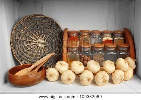 Variety spices on kitchen shelf
