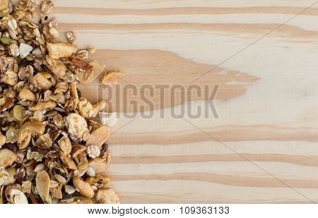 Pile Of Granola Cereal On The Wood Background