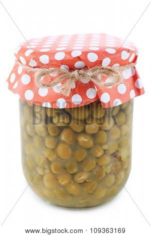 Glass jar of preserved peas