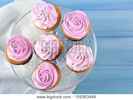Tasty cupcake on stand, close-up