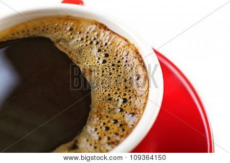 A red cup of tasty coffee, isolated on white, close-up