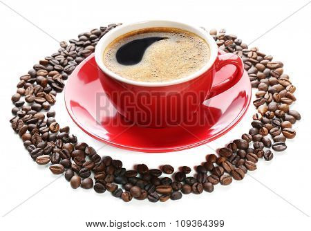 A red cup of tasty drink and scattered coffee grains in the shape of circle, isolated on white