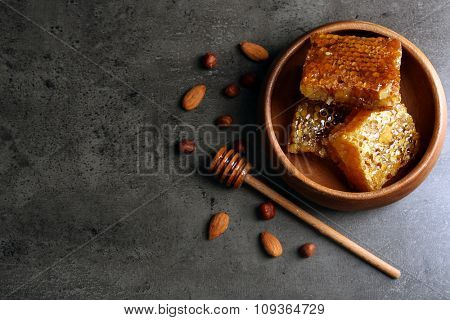 Honeycombs on plate on gray background