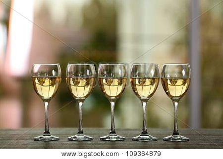 Wine glasses with wine on a table outside