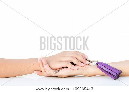 Hand In Hand On The White Table With The Key In Hand
