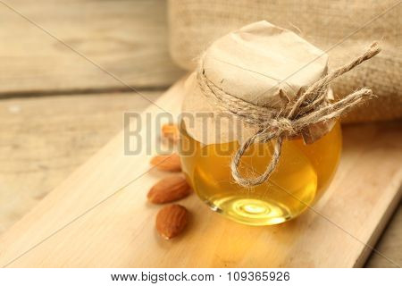 Honey jar on wooden background