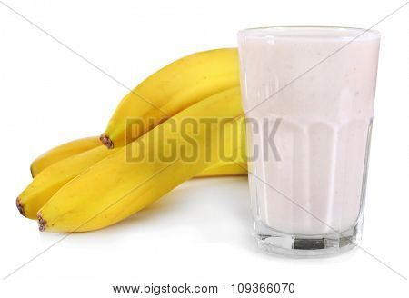 A glass of fresh cold banana smoothie, isolated on white