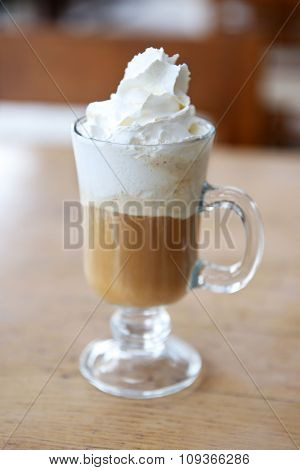 Iced coffee on table in cafe, closeup