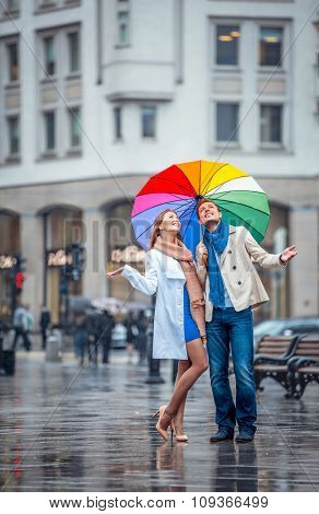 Young couple with umbrella outdoors