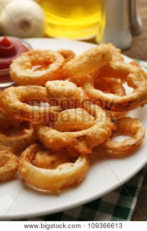 Chips rings with sauce on plate