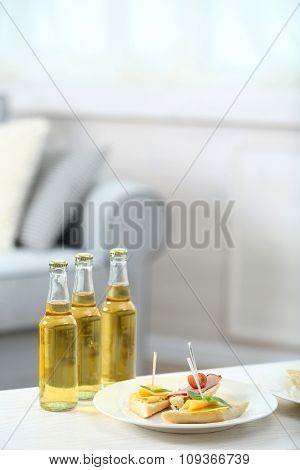 Table at home with chips and drinks for friends