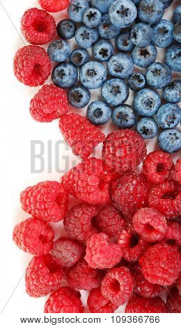 Heart shaped raspberries and blueberries closeup