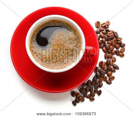 A red cup of tasty drink and scattered coffee grains, isolated on white, top view