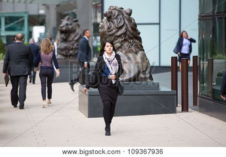 London, Young women going at work. Early morning hours in Canary Wharf business life