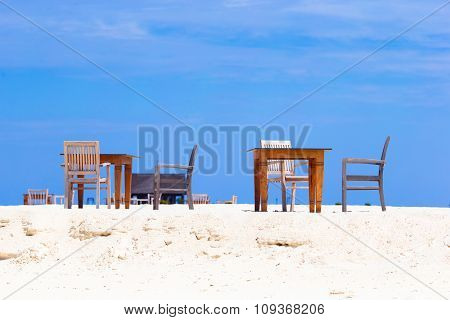 Summer empty outdoor cafe on exotic shore