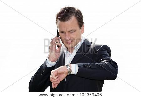 Businessman having conversation on mobile phone isolated white.