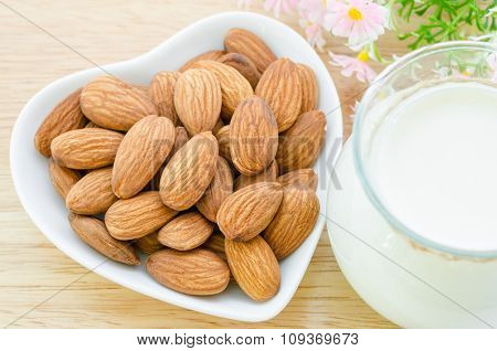 Almond Milk With Almond On A White Bowl Cup.