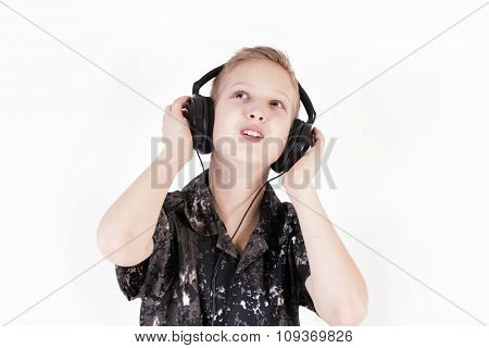 Teenager listening music with headphones, isolated on pure white.