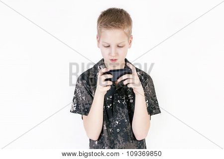 Teenager searching something on a smartphone isolated.