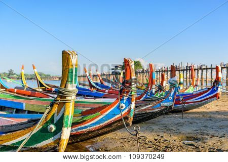 Mandalay, Myanmar boats on the  Taungthaman Lake in front of U Bein Bridge.