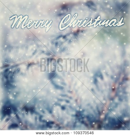 Vintage Christmas greeting card background, beautiful vintage abstract background with text space, coniferous tree branch covered with hoar frost, selective focus on the text