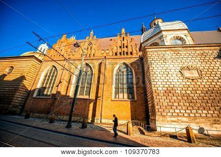 Man walking the street near church in Krakow