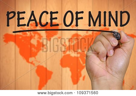 Hand Writing Peace Of Mind Over Blur World Background