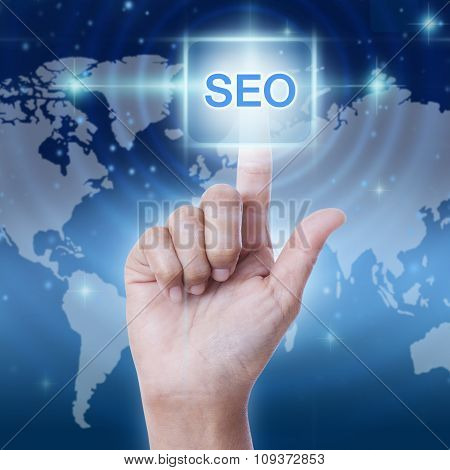 hand pressing seo sign on virtual screen. business concept