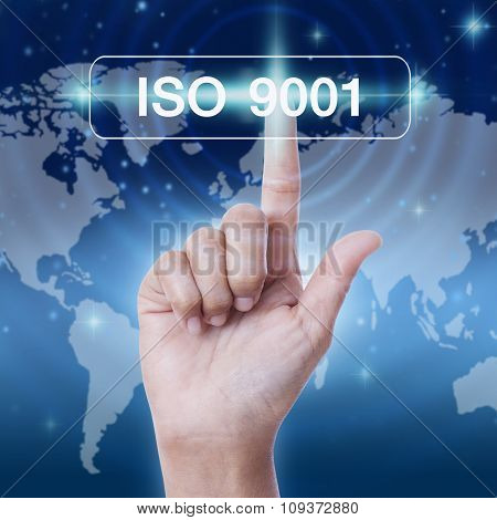 hand pressing iso 9001 sign on virtual screen. business concept