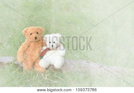 Two Teddy Bears Hugging On Paper Textured Background