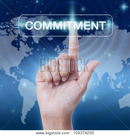 hand pressing commitment word button on virtual screen. business concept
