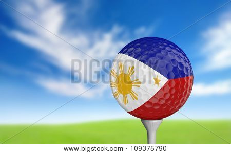 Golf ball with Philippines flag colors sitting on a tee
