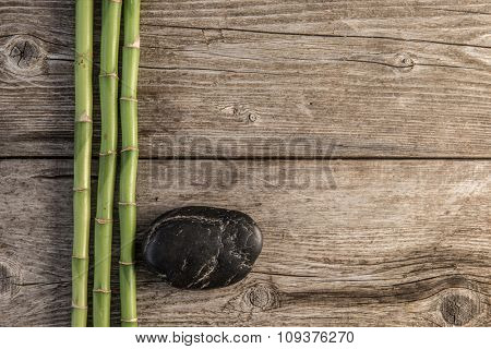 zen basalt stones and bamboo on the wooden baord background