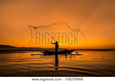 Fisherman Of Bangpra Lake In Action When Fishing, Thailand.