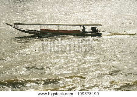 Long Tail Boat In River