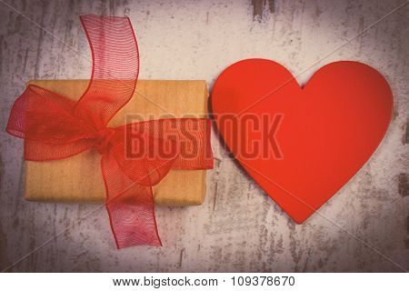 Vintage Photo, Wrapped Gift For Valentines Day And Red Heart On Old Wooden Table