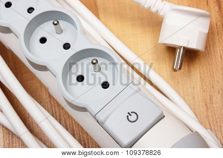 Electrical Power Strip With Switch On-off On Wooden Floor