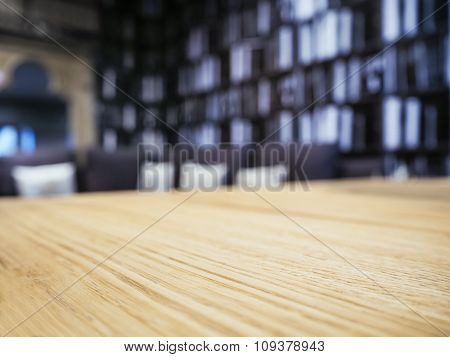 Table Top With Blurred Sofa Pillows and Book Shelf Background