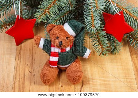 Teddy Bear With Spruce Branches And Star Shape For Christmas