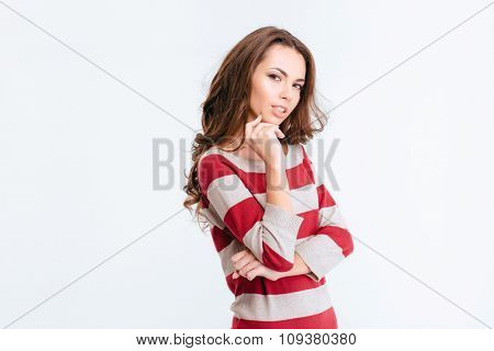 Portrait of a happy thoughtful woman looking at camera isolated on a white background