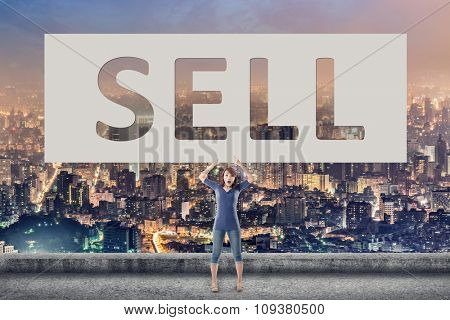 Sell, words on blank board hold by a young girl in the outdoor.