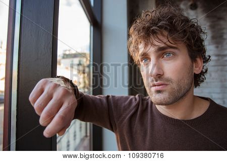 Portrait of handsome thoughtful guy standing