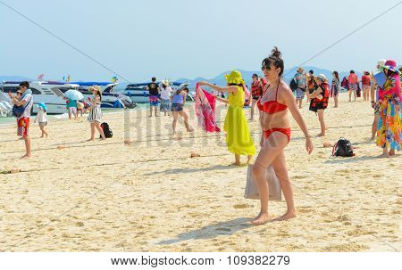 People Relaxing, Swimming, Shooting Photo, Having Fun On The Beach.